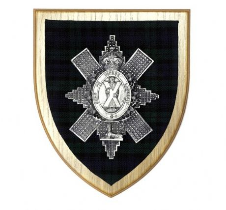 Metallic finished Black Watch cap badge set against the regimental tartan on a solid wooden plaque. The Royal Highlanders wall plaque.